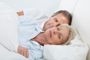 Happy Senior Couple On Sleeping Bed