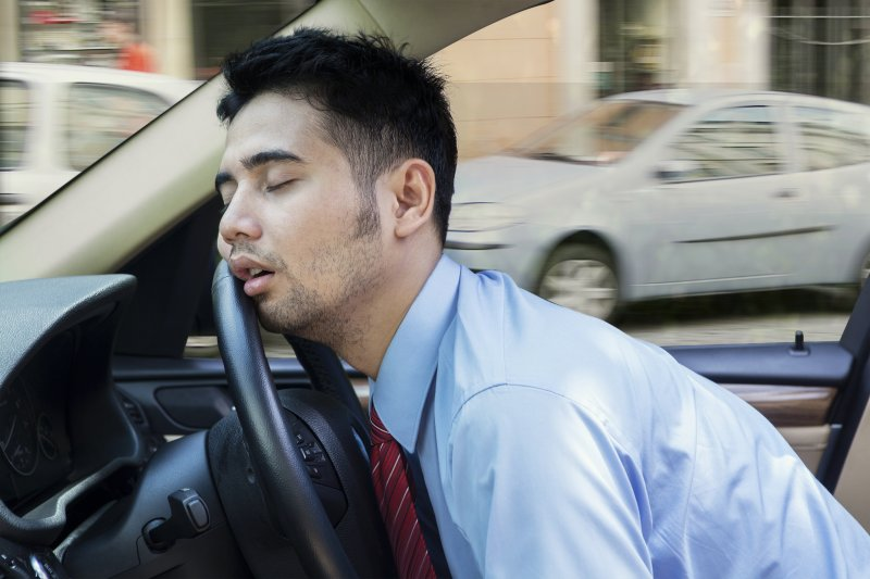 man sleeping driving